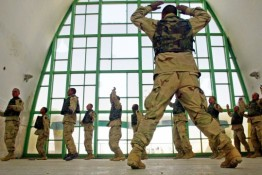 400738 02: U.S. Army soldiers from the 101st Airborne do jumping jacks as they exercise February 8, 2002 at the Kandahar Airbase in Kandahar, Afghanistan. (Photo by Joe Raedle/Getty Images)